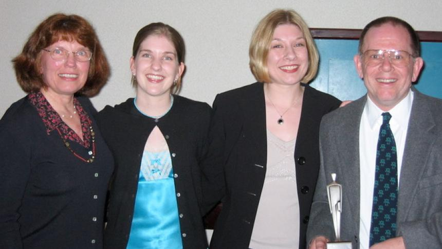 Steve Dustrude with his wife Cyndy and daughters, Erin and Amy, after he received an OEA award for member rights
