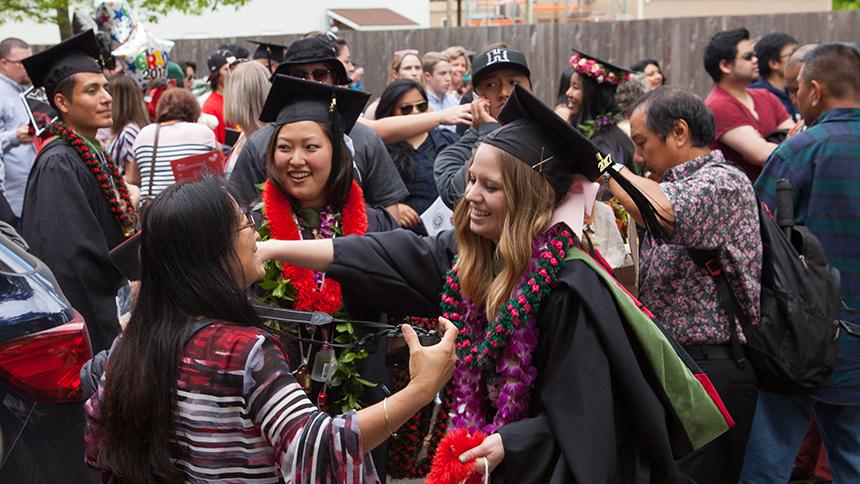 Graduates hug family and friends at Commencement
