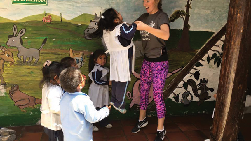 Shannon Hammond working with the children in Ecuador