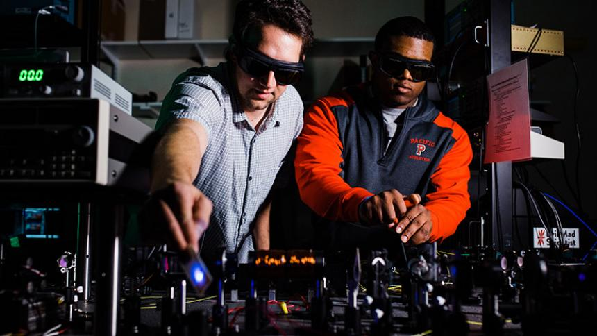 Andrew Dawes and Kevin McGee '18 in the laser lab