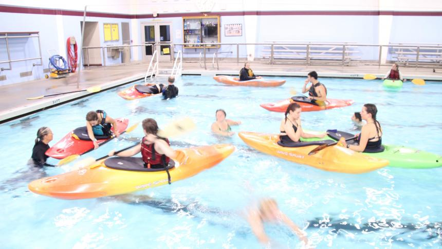 Kayakers practicing in a pool