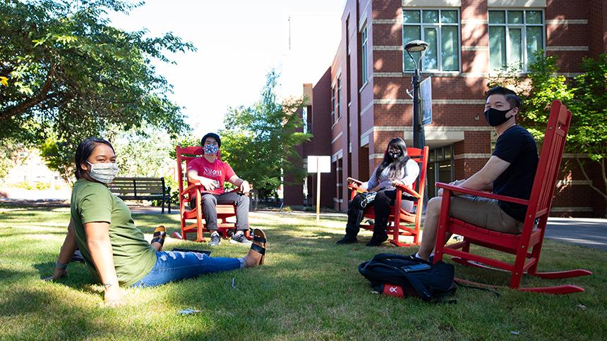 Students sitting together on lawn