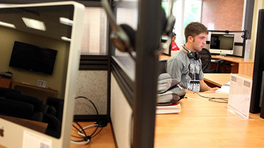 student sitting at a CLIC computer