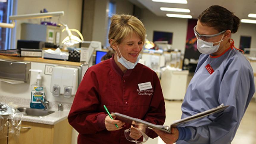 Dental hygienist providing dental hygiene services
