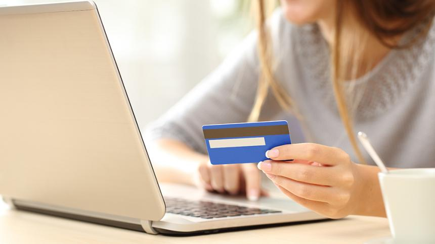Woman at laptop with credit card