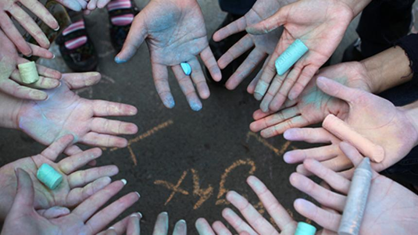 chalk covered hands