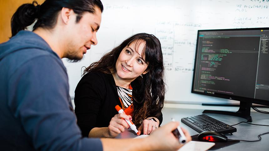 Professor and student working in computer science class