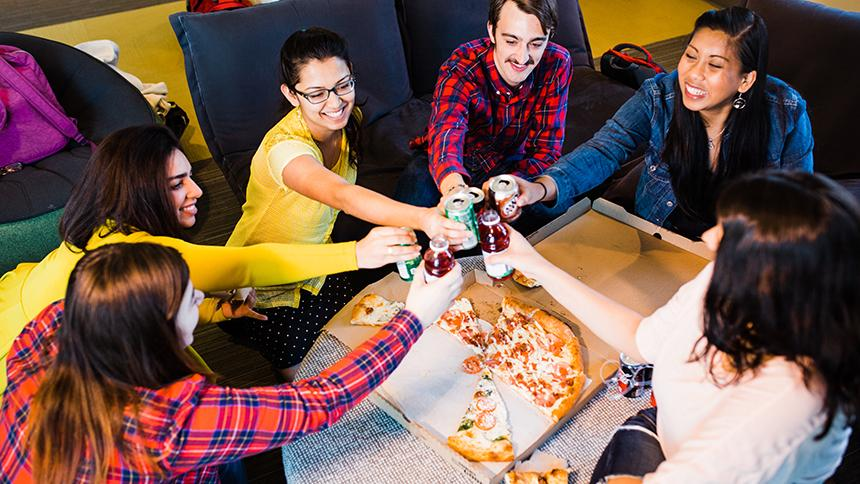 Students gathered for pizza