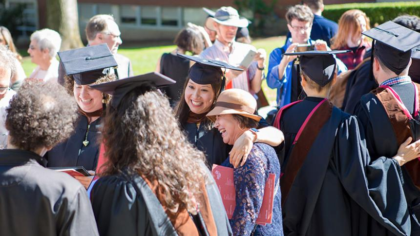 Graduates with family and friends at June Commencement