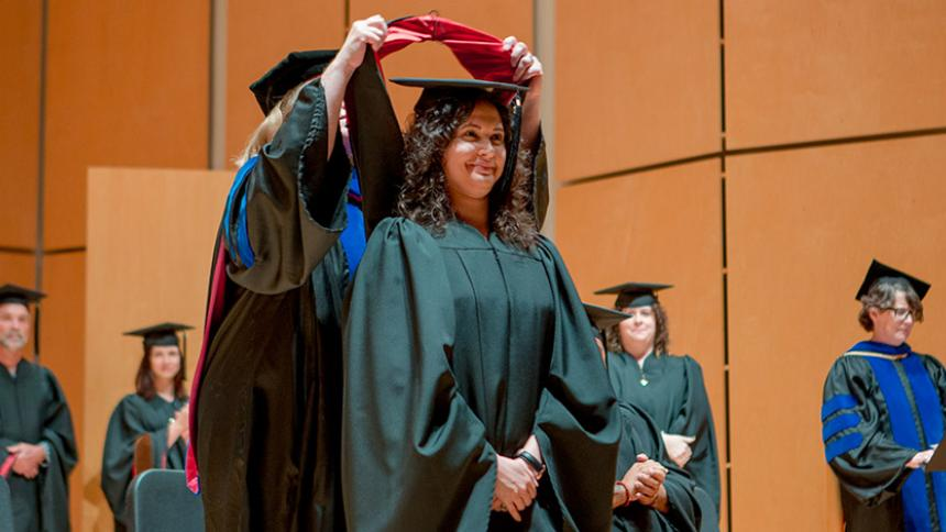 Graduating student hooding at June Commencement