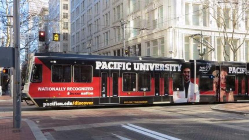 MAX train with Pacific University advertisement