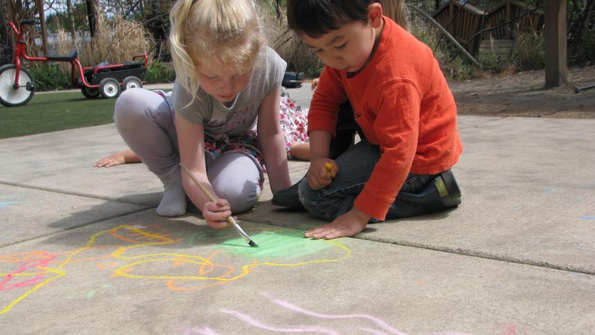 Children playing on sidewalk