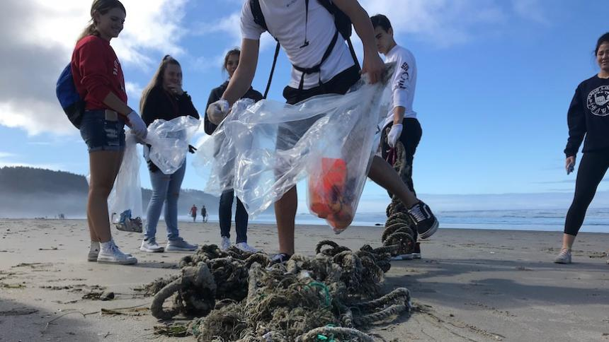 Students cleaning up beach