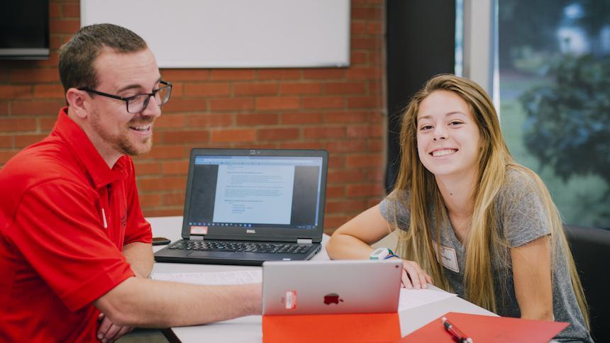 Advising center advisor and student