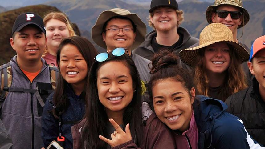 Students abroad smile for the camera.