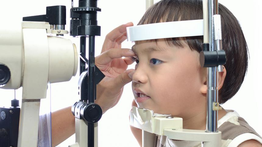 Child being examined by eye doctor