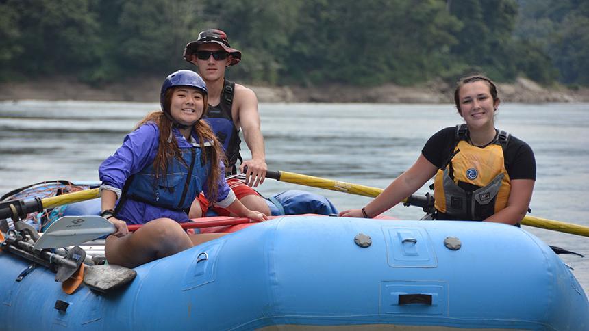 Three students in raft