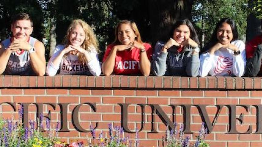 Students on entrance wall of Pacific University