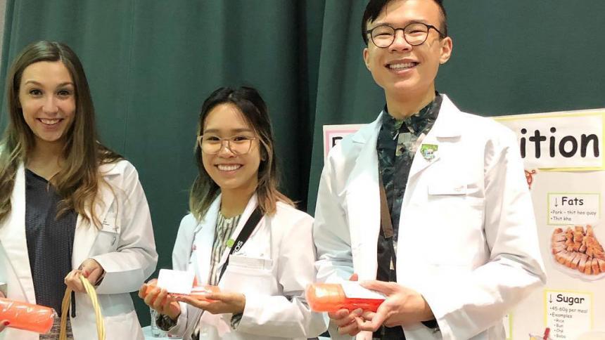 Pharmacy students present medication information at Portland Tet Festival