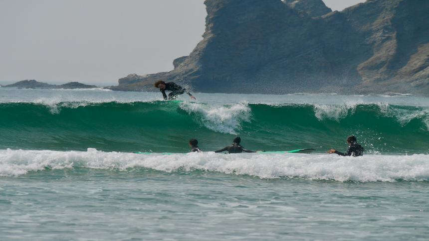 Surfers catch some waves along the Oregon coast.