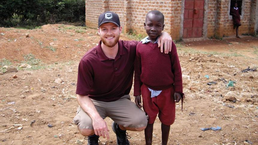 Corby pictured with a child on his mission trip.
