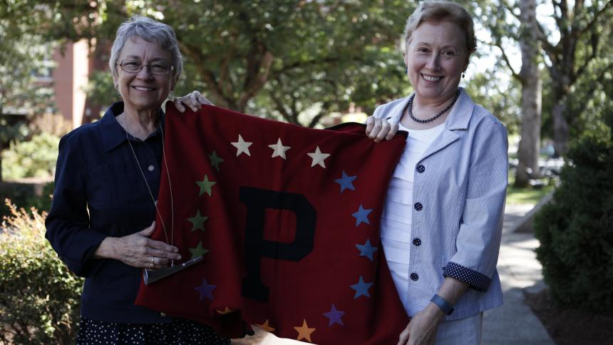 Susan Pool and Linda Ikeda display their grandfather's blanket and coaching horn.