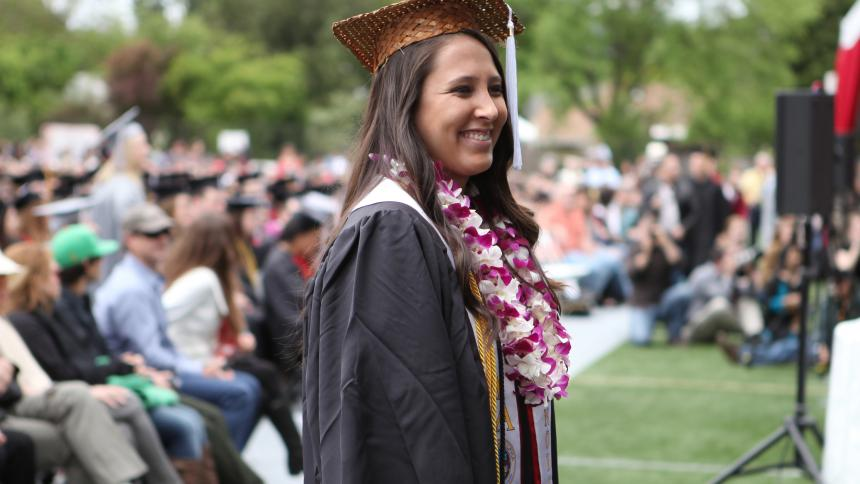Charlotte Basch '14 approaches the stage to receive her degree at Commencement 2014.
