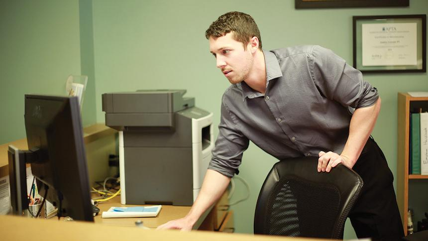 Bryan Lang working in his office.