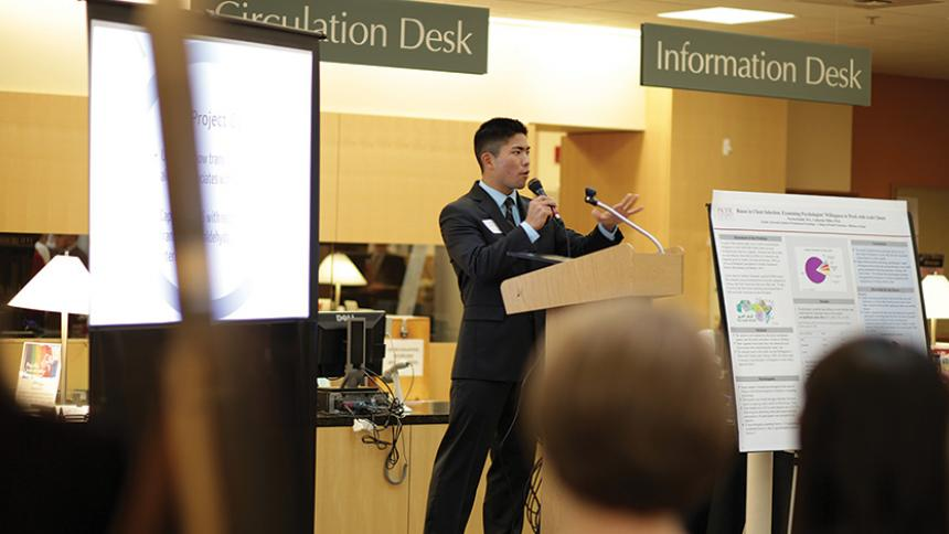 Tyler Oshiro '13 Giving a presentation