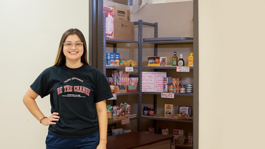 Ruth Gomez '19 in front of the Boxer Food Share