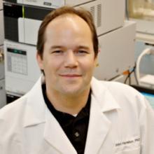 Photo of John Harrelson in the lab