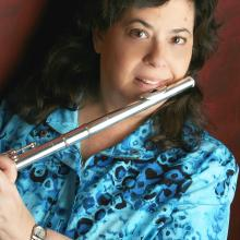 headshot of Phyllis Louke with a flute.
