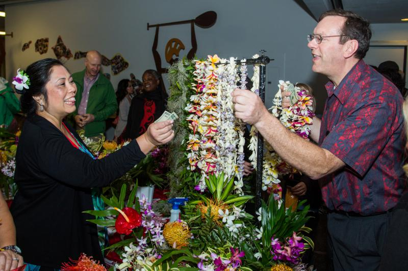 Woman buys leis from the country store